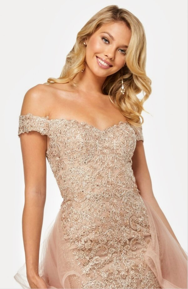 Model wearing beige sparkling pageant dress