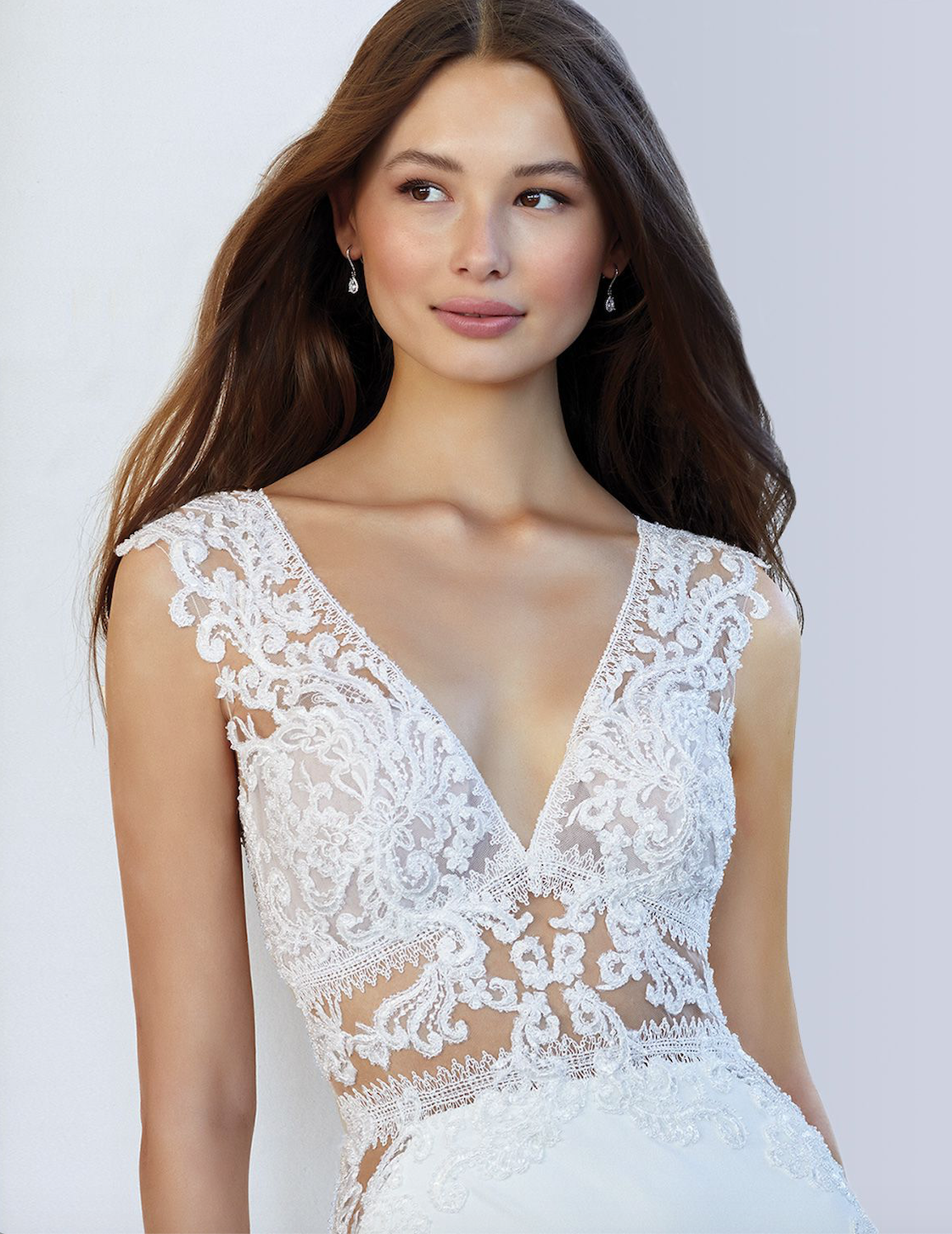 Model wearing white Justin Alexander dress
